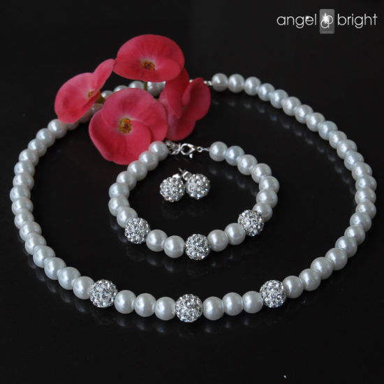 Set of earrings, bracelet and necklace white pearls-zircons
